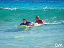 Our surf instructors push you into the waves.