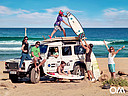 surfer with Landrover Defender at the beach
